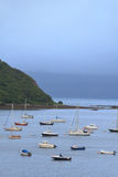 Boats lying at anchor in a bay Stock Images