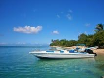 Boats lying at the sandy beach Stock Photos