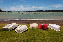 Boats lying upside down on shore in Bay of Islands Royalty Free Stock Photos