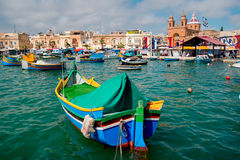 Boats on Malta island. Traditional maltese painted boats at the Marsaxlokk bay Royalty Free Stock Photos