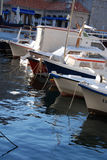 Boats in Marina. A variety of fishing boats docked in a marina royalty free stock images