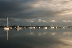 Boats on a marina on cloudy day Royalty Free Stock Images