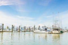 Boats at the marina by Fisherman`s Wharf in Steveston, BC, Canada. STEVESTON, BRITISH COLUMBIA, CANADA - JUNE 2017: various boats docked at the marina by the Royalty Free Stock Photo