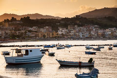 Boats in marina of Giardini Naxos town on sunset Royalty Free Stock Photography