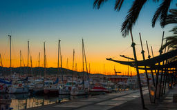 Boats in marina harbor at the end of a warm sunny day in Ibiza, St Antoni de Portmany Balearic Islands, Spain Royalty Free Stock Photography