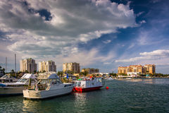 Boats in a marina and hotels along the Intracoastal Waterway in Royalty Free Stock Photo