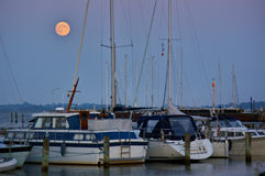 Boats in a marina on the island of Ærø, Denmark at full moon Stock Photo