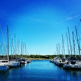 Boats at the Marina. Boats lined up up at the harbour, seaside Royalty Free Stock Photography