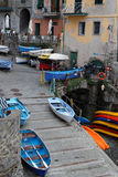 Boats in the marina of Manarola Stock Images