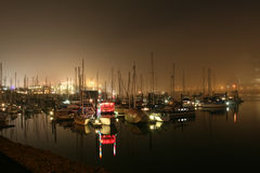 Boats in marina at night Royalty Free Stock Images