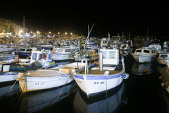 Boats in marina at night Royalty Free Stock Photo
