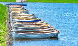 Boats marina river sea ocean grass, fish fishing summer shore waves Royalty Free Stock Photos