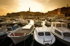 Boats in marina of Rovinj at sunset Stock Photography