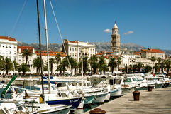 Boats in marina in Split, Croatia. Boats in marina along waterfront of Split, Croatia on sunny day with view of Cathedral of Saint Domnius Stock Photography