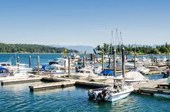 Boats in a Marina under Clear Sky. Mortboats Tied up to Jetties in a Harbour on a Clear Summer Day. Sooke, BC, Canada royalty free stock images