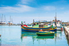 Boats in Marsaxlokk harbor. Fishing boats in Marsaxlokk harbor. Malta Stock Photos
