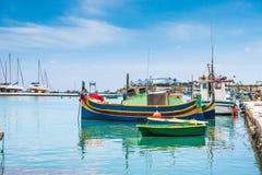 Boats in Marsaxlokk harbor Stock Photos