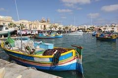 Boats in Marsaxlokk harbor on Malta island. Boats and market in Marsaxlokk harbor on Malta island Stock Photos