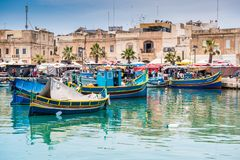 Boats in Marsaxlokk harbor. MARSAXLOKK HARBOR, MALTA - MAY 24: Fishing boats in Marsaxlokk harbor. Malta on May 24, 2015 Stock Images