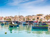 Boats in Marsaxlokk harbor. MARSAXLOKK HARBOR, MALTA - MAY 24: Fishing boats in Marsaxlokk harbor. Malta on May 24, 2015 Royalty Free Stock Images