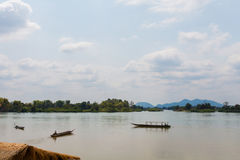 Boats on Mekhong Don Det. Boats on Don Det island in south Laos. Landscape of nature taken on four thousands islands Si Phan Don on Mekhong river in south east stock photos