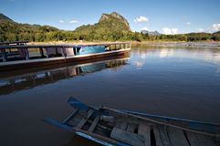 Boats on the Mekong River in Laos. Boats outside Tham Ting (one of two caves at Pak Ou) on the Mekong River in Laos Royalty Free Stock Image