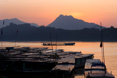 Boats on the mekong river by sunset Stock Photo