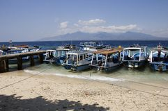 Boats at Menjangan island and view of Bali island Royalty Free Stock Photos