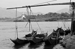 Boats on the mighty Mekong River, Thailand and Laos. Small boats on the Mekong River between Loas and Thailand, near Chiang Khong, Thailand Stock Photo