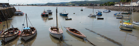 Boats in Minehead harbour Somerset England uk in summer with blue sky on a beautiful day. Minehead harbour Somerset England uk in summer with blue sky on a Royalty Free Stock Images
