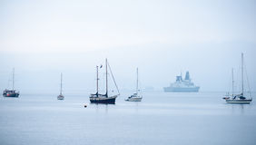 Boats in the mist Stock Photos