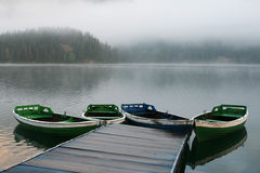 Boats on misty morning Royalty Free Stock Image