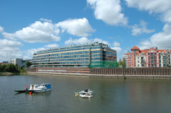 Boats and modern building at Warta river in Poznan, Poland Royalty Free Stock Photography