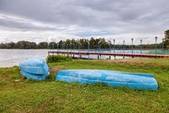 Boats at the monastery pier on Lake Valday, Russia Stock Photo