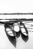 Boats in monsoon. After rain stopped the water filled boats looked differently which suited for a good black and white photo Royalty Free Stock Photos