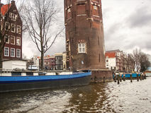Boats and Montelbaans Tower on the canal in Amsterdam. Netherlan Royalty Free Stock Image