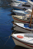 Boats at moorage. A few boats at moorage by a large plan Stock Photo