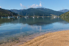 Boats moored at Anakiwa harbour in Marlborough Sounds Stock Image