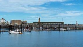 Boats Moored At Marina Under Cloudy Blue Sky stock photos