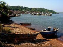 Boats moored in bay Royalty Free Stock Photo