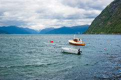 Boats moored at the bay of Sognefjord Royalty Free Stock Photo