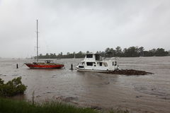 Boats moored in Brisbane River during flooding royalty free stock photos