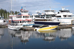 Boats moored in Burrard inlet Vancouver BC Canada. stock photos