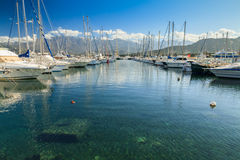 Boats moored in Calvi harbour in Corsica Stock Images