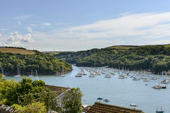 Boats moored in Fowey Polruan cove, Cornwall Royalty Free Stock Images