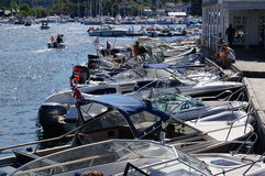 Boats moored in front of a restaurant, Norway Royalty Free Stock Photos