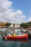 Boats moored in harbor at Garda on Lake Garda Italy Royalty Free Stock Photography