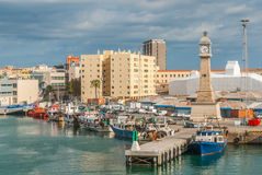Boats moored in the harbor at Marina, Port Vell in Barcelona, Spain. Royalty Free Stock Photography