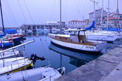 Boats moored in the harbor of Muggia stock image