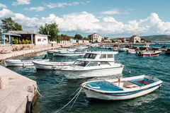 Boats moored in harbor. Row of boats moored in harbor Royalty Free Stock Photography